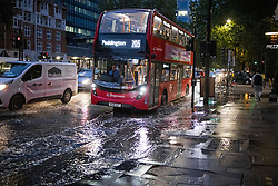 © Licensed to London News Pictures. 21/10/2021. London, UK. Surface water slows down traffic on the Euston road in North London caused by heavy rain over night in the capital. Flash flooding hit parts of the south east as Storm Aurore brought winds of up to 45mph . Photo credit: Ben Cawthra/LNP