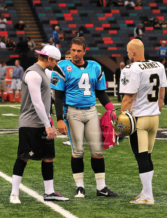 """New Orleans Saints kicker John Carney, recently resigned, is seen giving instructions to New Orleans kicker Garrett Hartley while the Carolina Panthers kicker John Kasey watches and gives advice prior to the Saints -v-Panthers game Sunday Oct. 3,2010. Carney went on to kick three feild goals to help the saints win while Hartley did not play at all. The NFL has gone """"Pink"""" for October in honor of Breast Cancer Awareness. The Saints went on to win 16-14. John Carney kicked three field goals to help the Saints win. PHOTO©SuziAltman.com"""