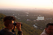 The landscape of Mandalay through binoculars, Mandalay Hill, Mandalay, Burma.<br /> Note: These images are not distributed or sold in Portugal