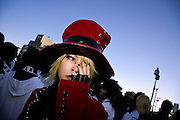 A Harajuku cos-play (costume play) girl in a red hat and jacket at the Meiji JIngu bridge near Harajuku Station. Cos-play is a sub culture fashion style where people dress up as characters from manga comics of Anime films. It originated in Tokyo near Harajuku but its popularity has now spread across the world. Harajuku, Tokyo, Japan Saturday October 10th 2007