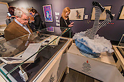Alice's upturned legs with hearts on the soles of her shoes - Alice in Wonderland  - a celebration of the 150th anniversary of the publication of Alice's Adventures in Wonderland. This new exhibition at the British Library explores how Alice has captured readers imaginations for so many years.  Although the story has been adapted, appropriated, re-imagined and re-illustrated since its conception, people are still enchanted by Carroll's original, which continues to inspire new generations of writers and illustrators. Highlights of the show include Lewis Carroll's original manuscript with hand-drawn illustrations, alongside stunning editions by Mervyn Peake, Ralph Steadman, Leonard Weisgard, Arthur Rackham, Salvador Dali and others.