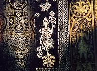 Laos, Luang Nam Tha, 2003. Afternoon light in Luang Prabang reveals a sublime golden goddess rising skyward like a lotus.