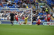 Cardiff's Sean Morrison (36 on ground ) puts the ball into his own net to score an own goal to make it 1-1.  Skybet football league championship match, Cardiff city v Sheffield Wed at the Cardiff city stadium in Cardiff, South Wales on Saturday 27th Sept 2014<br /> pic by Andrew Orchard, Andrew Orchard sports photography.