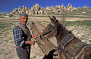 Goreme, Cappadocia, Nevsehir, Turkey. A farmer plows the land with a horse drawn plough. Although toursim is upcoming, many people still live of their traditional livelyhood. they work the fields in the fairy chimney landscape of Cappadocia and the Goreme National Park. Photo by Frits Meyst/Adventure4ever.com
