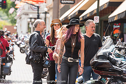 Michael Lichter photographing the Jacobs famly just outside their Scott Jacobs gallery on Main Street in Deadwood during the annual Sturgis Black Hills Motorcycle Rally. Deadwood, SD, USA. Monday August 7, 2017.  Photography ©2017 Jonathan Pite.