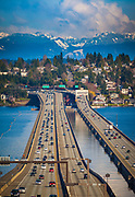 The Lacey V. Murrow Memorial Bridge is a floating bridge that carries the eastbound lanes of Interstate 90 across Lake Washington from Seattle to Mercer Island, Washington. It is the second longest floating bridge on Earth at 6,620 ft (2,020 m), whereas the longest is the Evergreen Point Floating Bridge just a few miles to the north on the same lake, built 23 years later. The third longest is the Hood Canal Bridge, also in Washington State, about 30 miles to the Northwest of the Evergreen Point Floating Bridge.