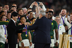 Chairman of World Rugby Sir Bill Beaumont passes the William Webb Ellis Trophy to the Crown Prince of Japan after the 2019 Rugby World Cup final match at Yokohama Stadium.