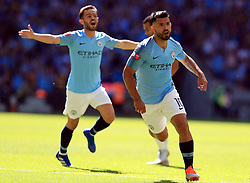 """Manchester City's Sergio Aguero celebrates scoring his side's first goal of the game during the Community Shield match at Wembley Stadium, London. PRESS ASSOCIATION Photo. Picture date: Sunday August 5, 2018. See PA story SOCCER Community Shield. Photo credit should read: Mike Egerton/PA Wire. RESTRICTIONS: EDITORIAL USE ONLY No use with unauthorised audio, video, data, fixture lists, club/league logos or """"live"""" services. Online in-match use limited to 75 images, no video emulation. No use in betting, games or single club/league/player publications."""