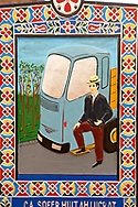 Tombstone of a lorry owner,  The  Merry Cemetery ( Cimitirul Vesel ),  Săpânţa, Maramares, Northern Transylvania, Romania.  The naive folk art style of the tombstones created by woodcarver  Stan Ioan Pătraş (1909 - 1977) who created in his lifetime over 700 colourfully painted wooden tombstones with small relief portrait carvings of the deceased or with scenes depicting them at work or play or surprisingly showing the violent accident that killed them. Each tombstone has an inscription about the person, sometimes a light hearted  limerick in Romanian. .<br /> <br /> Visit our ROMANIA HISTORIC PLACXES PHOTO COLLECTIONS for more photos to download or buy as wall art prints https://funkystock.photoshelter.com/gallery-collection/Pictures-Images-of-Romania-Photos-of-Romanian-Historic-Landmark-Sites/C00001TITiQwAdS8