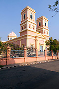 A man walks past the church of Notre Dame de Anges, Pondicherry, India. Built in the 1850s the church is in the  French Quarter of the town and looks out towards the Indian Ocean.