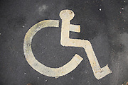 Disabled parking sign on tarmac
