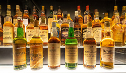 The oldest bottles of Scotch Whisky in the collection at   at the Scotch Whisky Experience visitor centre on the Royal Mile in Edinburgh, Scotland, UK