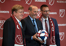 Oct 21, 2019; Sacramento, CA, USA; Sacramento Republic FC ownership Ron Burkle, left, and Matt Alvarez pose with MLS Commissioner Don Garber, center, during the announcement that Major League Soccer has award an expansion team to Sacramento, at The Bank. Mandatory Credit: D. Ross Cameron-USA TODAY Sports