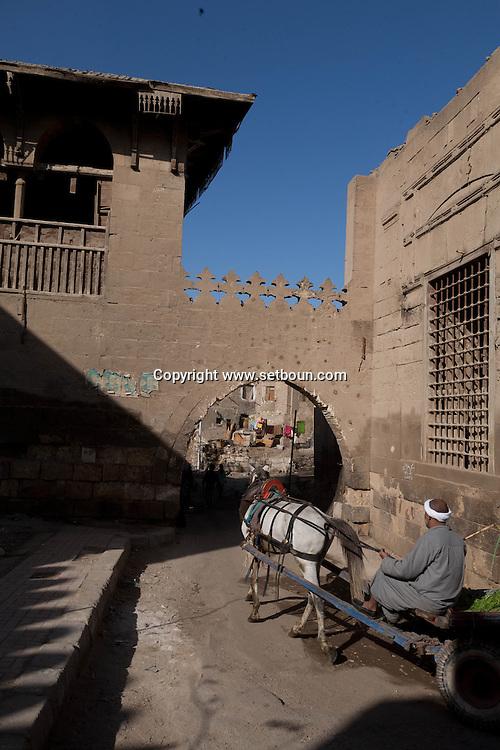 Egypt . Cairo : GATE entrance to the cemetery north. TARABAY ASH SHARIFI. Sabil Kuttab and mausoleum - in ruins- in bab al Wazir area,    in islamic cairo
