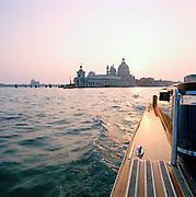 Basilica di Santa Maria della Salute, St Mary of Health, seen from a motor boat in Venice, Italy