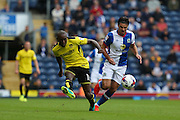 Lloyd Dyer of Burton Albion plays back whist under pressure from Ben Marshall of Blackburn Rovers during the EFL Sky Bet Championship match between Blackburn Rovers and Burton Albion at Ewood Park, Blackburn, England on 20 August 2016. Photo by Simon Brady.