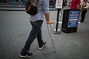 Angel Santiago makes his way toward security before catching a flight to Philadelphia to visit family from Orlando International Airport in Orlando, Florida, U.S. Santiago had arranged for a wheelchair escort, but decided to make it to the gate unassisted. He traveled alone.