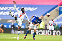 LEICESTER, ENGLAND - JULY 04: Jonny Evans of Leicester City heads clear from Christian Benteke of Crystal Palace during the Premier League match between Leicester City and Crystal Palace at The King Power Stadium on July 4, 2020 in Leicester, United Kingdom. Football Stadiums around Europe remain empty due to the Coronavirus Pandemic as Government social distancing laws prohibit fans inside venues resulting in all fixtures being played behind closed doors. (Photo by MB Media)