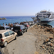 Car queue driving to the ferry in the docks of Chora Sfakion, Crete