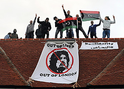 ©London News pictures. 09/03/11. Squatters on the roof of a house belonging to the Gaddafi family in Hampstead today. Picture Credit should read Stephen Simpson/LNP