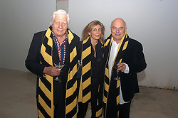 Left to right, GUNTHER SACHS and his son designer ROLF SACHS and MRS ROLF SACHS at an exhibition of work by Rolf Sachs - a unique world-renowned contemporary furniture designer, held in association with the Louisa Guinness Gallery and held at 250 Brompron Road, London on 6th October 2004.<br />
