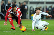 Southampton's Virgil Van Dijk (l) and Swansea's Alberto Paloschi go to the ground after a collision. Barclays Premier league match, Swansea city v Southampton at the Liberty Stadium in Swansea, South Wales on Saturday 13th February 2016.<br /> pic by  Carl Robertson, Andrew Orchard sports photography.