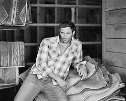 sexy man in a barn