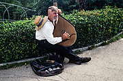 Male musician busker playing ud instrument, Yalta, Crimea, Russia 1997