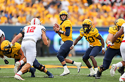 Sep 14, 2019; Morgantown, WV, USA; West Virginia Mountaineers quarterback Austin Kendall (12) drops back to pass during the first quarter against the North Carolina State Wolfpack at Mountaineer Field at Milan Puskar Stadium. Mandatory Credit: Ben Queen-USA TODAY Sports