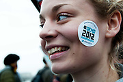 November 21st. Westminster. Demonstration organised by National Union of Students (NUS) against education cuts. A young woman has a sticker on her cheek  saying ' Demo 2012. Educate. Employ. Empower'.