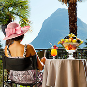 portrait of beautiful woman on the terrace of prestigious hotel