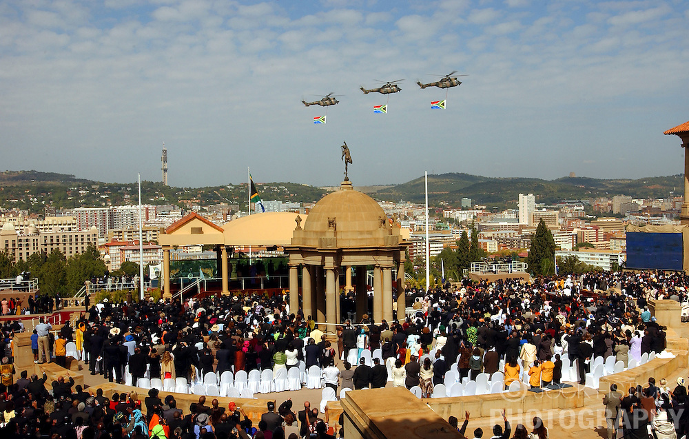 PRETORIA, SOUTH AFRICA - APRIL-27-2004 - Three helicopters fly the South African flag over the inauguration ceremony for South African President Thabo Mbeki , which marks the 10th Anniversary of the fall of Apartheid in South Africa. (PHOTO © JOCK FISTICK)
