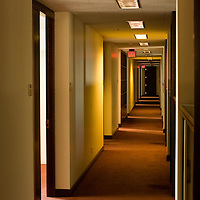 An empty hallway in an empty office building. Deserted by employees.