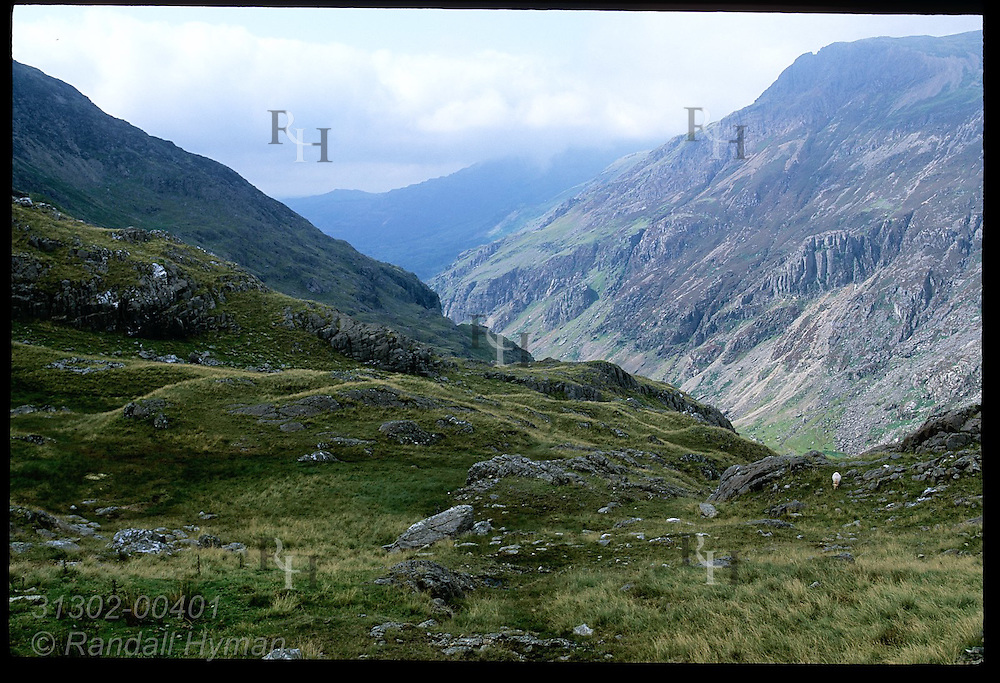 Massive mountain walls jut from valley, as seen from Pyg Track, in Snowdonia National Park; Wales.