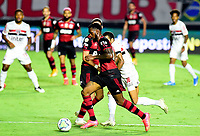 SAO PAULO, BRAZIL - FEBRUARY 25: Gerson of CR Flamengo competes for the ball with Dani Alves of Sao Paulo FC ,during the Brasileirao Serie A 2020 match between Sao Paulo FC and CR Flamengo at Morumbi Stadium on February 25, 2021 in Sao Paulo, Brazil. (Photo by MB Media/BPA)