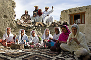 Villagers spin wool and knit together in mountain village of Altit in Karokoram Mountains, Pakistan