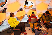 Glaciologists stay busy inside their basecamp tent at the Columbia Glacier, near Valdez, Alaska.
