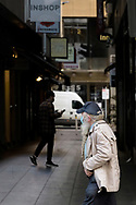 An old man with a large matted beard walks through Bourke Street. (Photo by Dave Hewison/Speed Media)