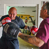 Ron Beca throws a punch at coach, Joe Olivas, as they train for the Young Guns boxing match. The fight will take place on July 9th at Santa Ana Star Center, in Rio Rancho.
