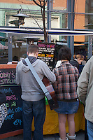 Queueing for smoothies at the Temple Bar food market in Dublin Ireland