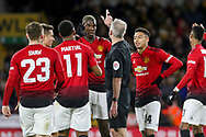 Manchester United Midfielder Paul Pogba argues with Referee Martin Atkinson after hand ball decision during the The FA Cup match between Wolverhampton Wanderers and Manchester United at Molineux, Wolverhampton, England on 16 March 2019.