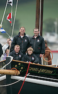 """The Spirit of Mystery being launched. Millbrook. Cornwall. UK.Pictures show the crowds watching as Pete Goss and his crew launch their new Cornish Lugger """"Spirit of Mystery""""..Royal Marines drum Spirit of Mystery as she kissed the water for the first time today...Eliot Goss (Pete Goss' son).Andy Goss (Pete Goss'  brother).Mark Maidment (Pete Goss'  brother in-law).Pete Goss..Please credit all pictures """"Lloyd Images"""""""