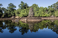 """Neak Pean """"The entwined serpents"""" is built on an artificial island with a Buddhist temple and was constructed during the reign of King Jayavarman VII.  The temple and lake represent Anavatapta - a mythical lake in the Himalayas - with waters that are believe to cure illnesses so Neak Pean was set up for medical purposes.  The ancients believed that going into the pools would cure diseases based on the ancient Hindu belief of balance. Four connected pools represent Water, Earth, Fire and Wind. The stone statues in pavilions are meant to represent the heads of the Four Great Animals."""