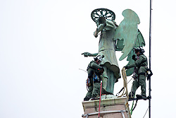 After two months of restoration, the Statue of Archangel Michael, made of copper plate, returned to Piran. The image shows Ales Hocevar and Jure Prezelj of 151st Rotary Wing Squadron climbing down after helicopter placing the statue on top of the church's clock, on October 15, 2018 in Piran, Slovenia. Photo by Matic Klansek Velej / Sportida