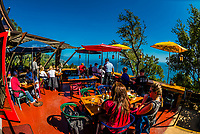 View from the terrace of the landmark Nepenthe Restaurant, which has tremendous views of the coastline at Big Sur, Monterey County, California USA.
