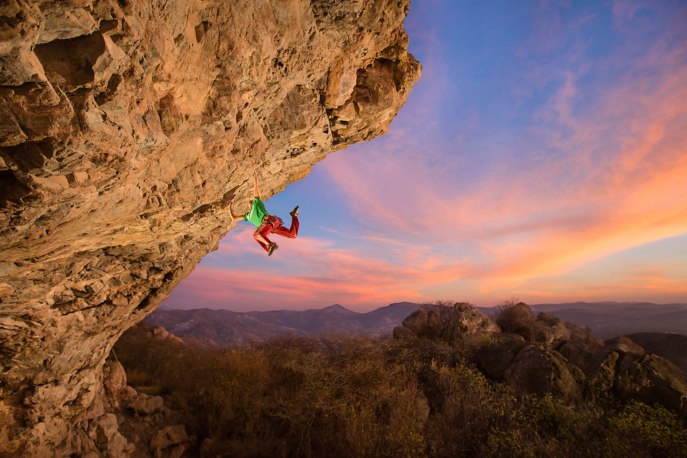 """Emiliano Fernández """"Chamán"""" with a dynamic move climbing """"El Jibaro"""" (5.13c/d). <br /> Client/Project: Personal project"""