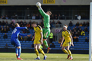 Oxford United goalkeeper Simon Eastwood (1) makes an important save during the EFL Sky Bet League 1 match between Oxford United and AFC Wimbledon at the Kassam Stadium, Oxford, England on 13 April 2019.