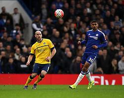 David Mirfin of Scunthorpe United plays a pass forward as Ruben Loftus-Cheek of Chelsea shuts him down - Mandatory byline: Robbie Stephenson/JMP - 10/01/2016 - FOOTBALL - Stamford Bridge - London, England - Chelsea v Scunthrope United - FA Cup Third Round