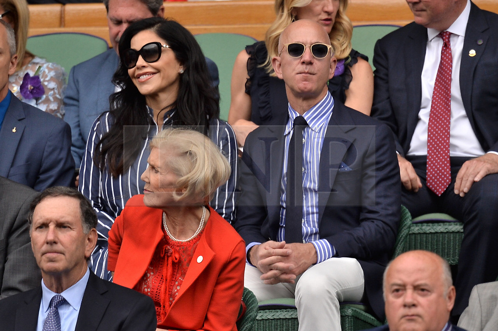 © Licensed to London News Pictures. 14/07/2019. London, UK. CEO and president of Amazon. com Jeff Bezos and Lauren Sanchez arrive to watch the mens singles finals on centre court tennis on Day 13 of the Wimbledon Tennis Championships 2019 held at the All England Lawn Tennis and Croquet Club. Photo credit: Ray Tang/LNP