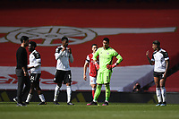 Football - 2020 /2021 Premier League - Arsenal v Fulham - Emirate Stadium<br /> <br /> Fulham players dejected as Referee Craig Pawson blows the whistle after they concede an injury time equaliser.<br /> <br /> COLORSPORT